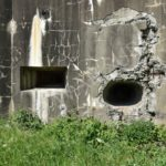 Left-Machine Gun Port.      Right-Blast from German Explosives